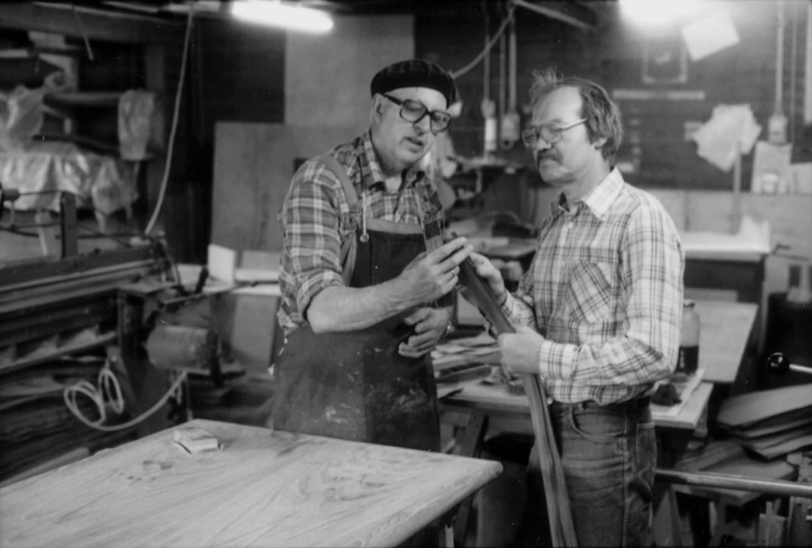 Historical photo of two employees in Dynaudio factory